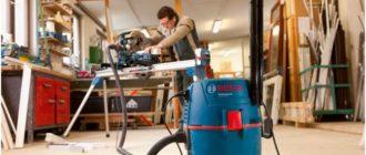 строительный пылесос, подключенный к оборудованию